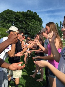 2018 students playing a game of 'rock, scissors, paper'.